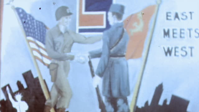 """army and soviet army soldiers shaking hands in front of """"east meets west"""" poster / torgau, germany - soviet military stock videos & royalty-free footage"""