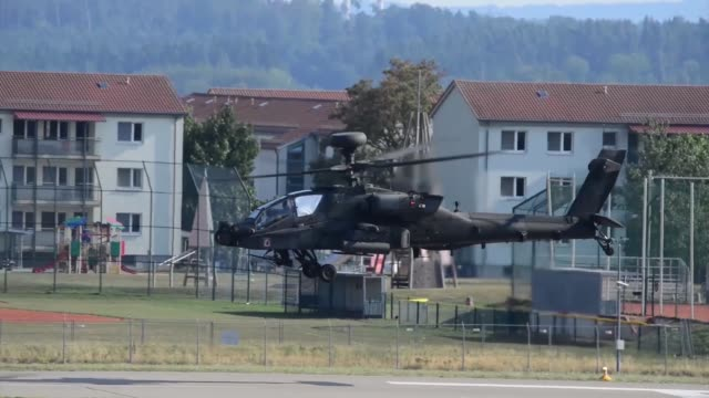 a us army apache helicopter with the 1st battalion 3rd aviation regiment conducts a traffic pattern training flight aug 1 at katterbach army airfield... - attack helicopter stock videos and b-roll footage