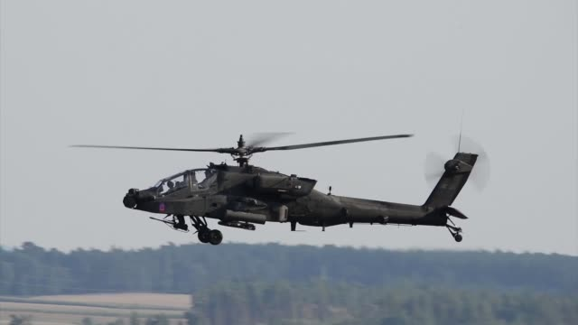 a us army apache helicopter with the 1st battalion 3rd aviation regiment conducts a traffic pattern training flight aug 1 at katterbach army airfield... - アパッチヘリコプター点の映像素材/bロール