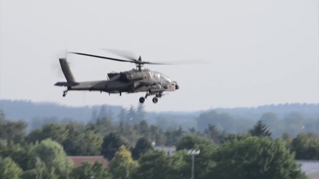 A US Army Apache helicopter with the 1st Battalion 3rd Aviation Regiment conducts a traffic pattern training flight Aug 1 at Katterbach Army Airfield...