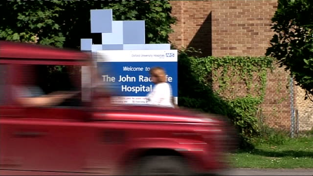 stockvideo's en b-roll-footage met army apologises for keeping dead soldiers body parts oxfordshire sign for 'the john radcliffe hospital' ambulances outside john radcliffe hospital - oxfordshire