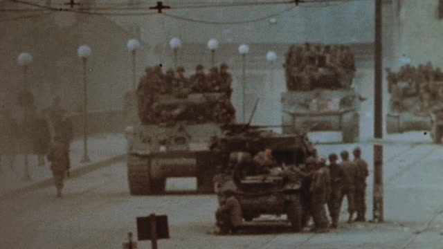 s army armored column entering captured town / austria - column stock videos & royalty-free footage