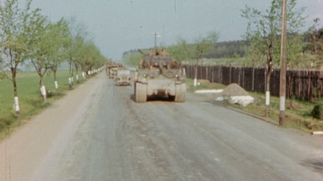 s army armored column with m2 halftracks and m4 sherman tanks advancing along city roadway - machine gun stock videos & royalty-free footage