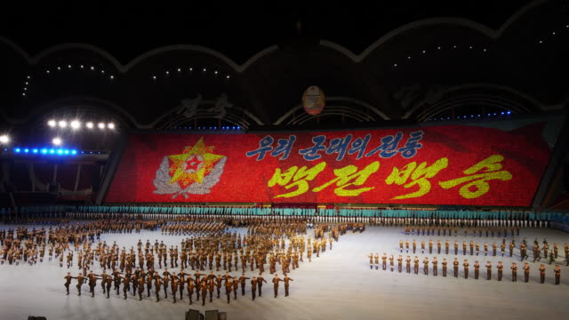 army band marching and performing in amazing formation during mass games in pyongyang, north korea, dprk. wide shot - north korea stock videos & royalty-free footage
