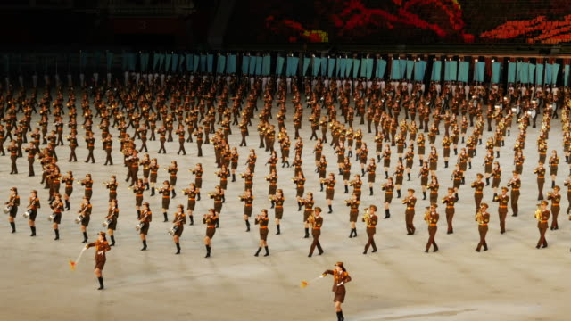 army band marching in amazing formation during mass games in pyongyang, north korea, dprk. medium shot - north korea stock videos & royalty-free footage