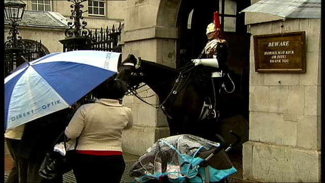 army buckingham palace guards caught being indiscreet tourists posing for photographs next palace guards guard wearing ceremonial helmet reporter to... - army helmet stock videos & royalty-free footage