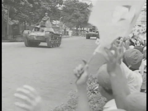 MANILA Army buglers VS Type 97 light tanks passing people roadside waving Japanese flags Soldiers in front of Type 95 heavy tanks Commanding Lt...