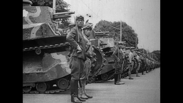 army buglers vs type philippines 97 light tanks passing people roadside waving japanese flags / soldiers in front of type 95 heavy tanks / commanding... - pacific war stock videos & royalty-free footage