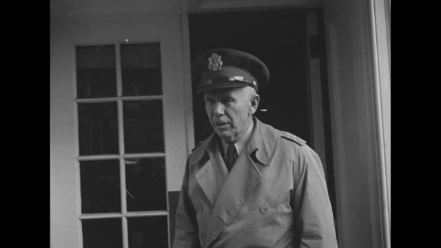 army chief of staff gen george marshall walks toward white house entrance stops to talk to photographers and journalists turns and enters white house... - womens army corps stock videos & royalty-free footage