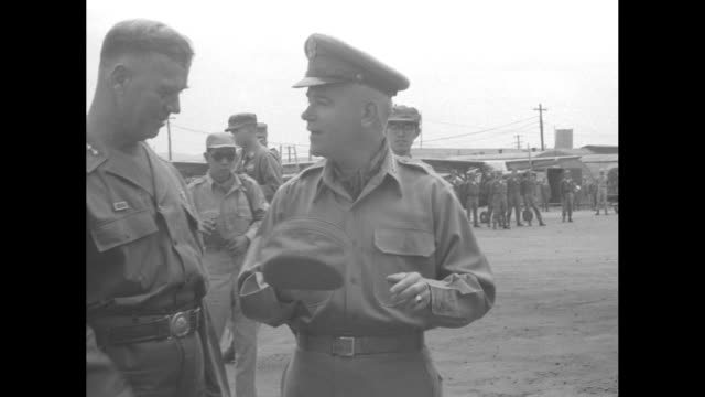 army chief of staff gen. j. lawton collins deplanes as he arrives in seoul for a tour of the east and west fronts in the korean war; he salutes,... - vangen stock-videos und b-roll-filmmaterial
