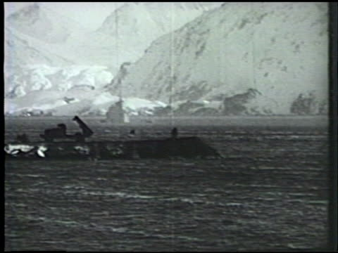 stockvideo's en b-roll-footage met s army construction battalion building land based bridge various heavy equipment including tractors plowing dirt for preparation of airfield airstrip... - alaska verenigde staten