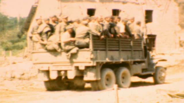 vidéos et rushes de army convoy with soldiers and french civilians looking on / german prisoners being trucked away from the front / dday german prisoners on june 06... - occupation