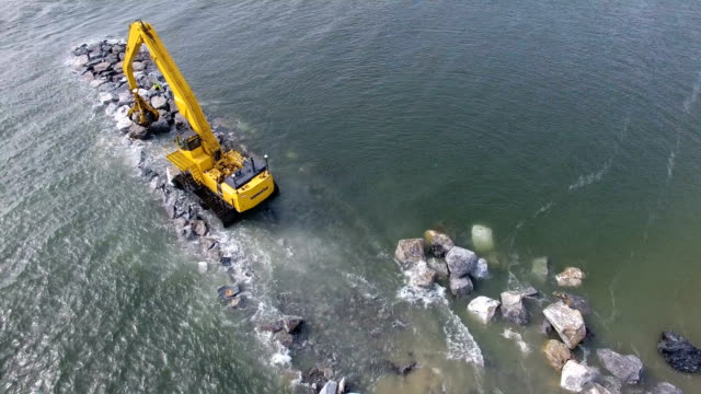 army corps of engineers rebuild a jetty in point lookout, ny aerial view - hurricane irene stock videos & royalty-free footage