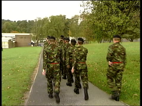 stockvideo's en b-roll-footage met army deepcut barracks open day attacked ms army recruits marching along pan soldiers taking part in media open day cms adam ingram mp interview sot... - rekruut