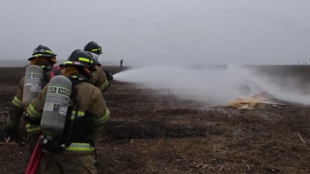 us army firefighters with the 336th engineer detachment participate in a simulated aircraft fire emergency response exercise with canadian and... - respiratory equipment stock videos & royalty-free footage
