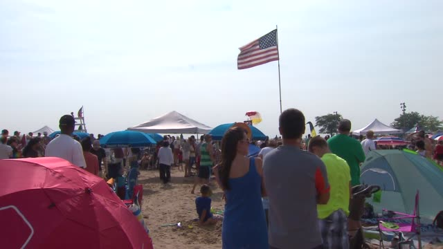 army golden knight paratroopers land on beach on august 17, 2014 in chicago, illinois. - chicago air and water show stock videos & royalty-free footage
