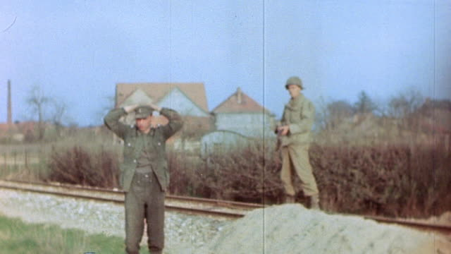 s army halftrack red cross ambulance and truck passing us army soldier holding german army prisoner of war at gunpoint during world war ii european... - railway track stock videos & royalty-free footage