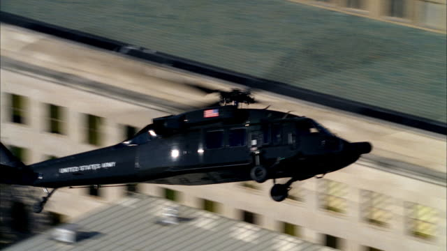 a us army helicopter circles around the pentagon as it patrols over washington, dc. - the pentagon stock videos & royalty-free footage