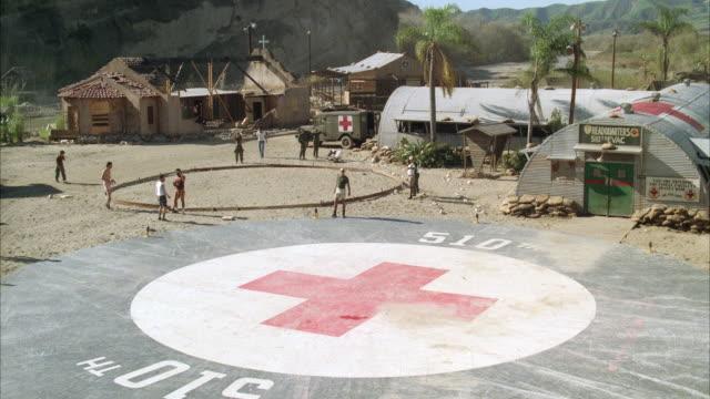 stockvideo's en b-roll-footage met ms army helicopter landing on pad at hospital evacuation base - plusteken