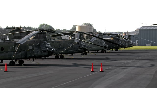aerial army helicopters at an airport - military base stock videos & royalty-free footage