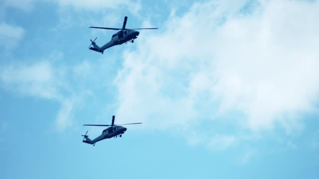 army helicopters flying in formation - army stock videos & royalty-free footage