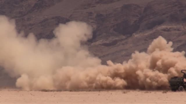stockvideo's en b-roll-footage met army high mobility artillery rocket system launch tests at the nevada test training range then loaded into a c17 - raket wapen