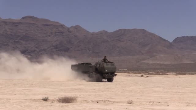 army high mobility artillery rocket system launch tests at the nevada test training range then loaded into a c17 - nevada stock videos & royalty-free footage