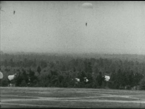 army infantry paratroopers descending w/ parachutes onto base field in treed area. wwii, training, airborne, parachute infantry regiment, display. - infantry stock videos & royalty-free footage