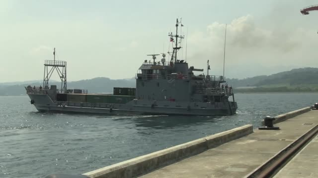us army landing craft units coming from okinawa japan carrying ammunition to support training events during exercise balikatan 2014 arrive at subic... - moored stock videos & royalty-free footage