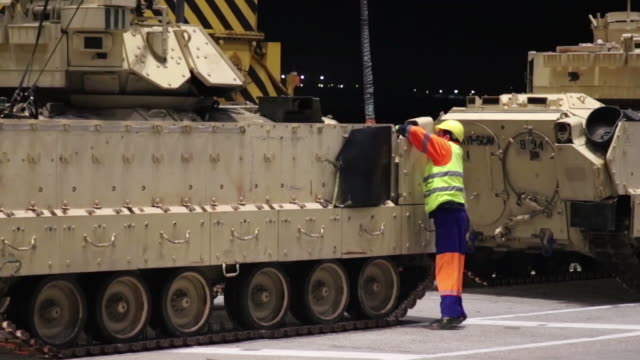 army m2a3 bradley fighting vehicles belonging to 1st cavalry division from fort hood texas are off-loaded by crane from a barge in the port of... - hochziehen stock-videos und b-roll-filmmaterial