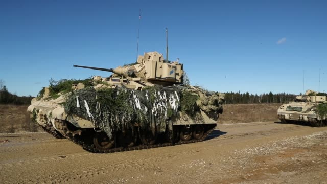 us army m2a3 bradley fighting vehicles of chaos company 168 armor battalion of the 3rd brigade combat team 4th infantry division during a joint... - 演習点の映像素材/bロール