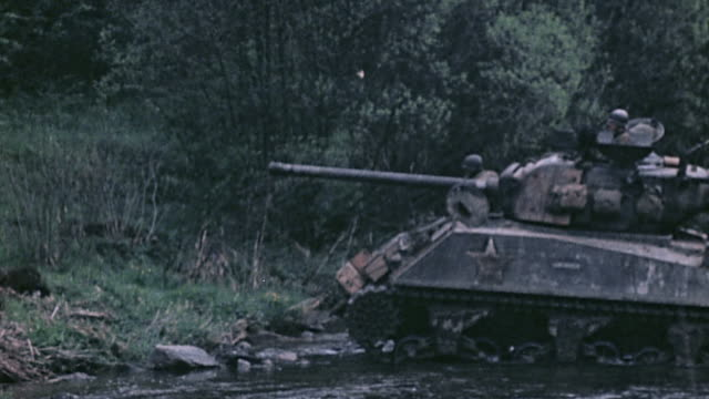 s army m4 sherman crossing stream with infantry hitching a ride / germany - infanterie stock-videos und b-roll-filmmaterial