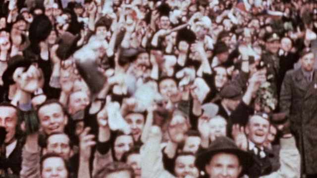 army m4 sherman tank decorated with czech flags driving through crowd of liberated villagers waving and welcoming their arrival / pilsen, czech... - ve day stock videos & royalty-free footage