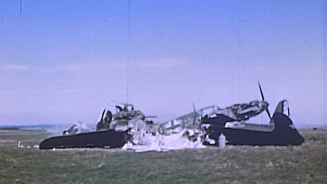 s army m4 sherman tank maneuvering around and through charred wreckage of german fighter planes during wwii european campaign / germany - luftwaffe stock videos and b-roll footage