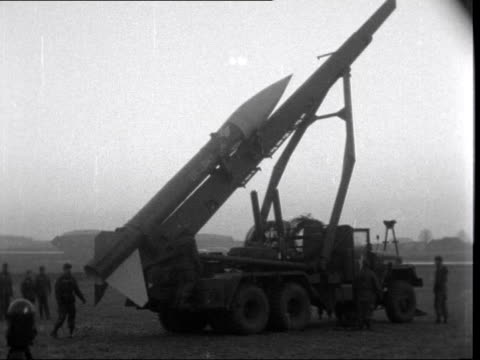 stockvideo's en b-roll-footage met west germany bavaria grafenwohr ext ms tanks towards in line cs observer watching thru' glasses cu tank past ms honest john rocket past on lorry bv... - raket wapen