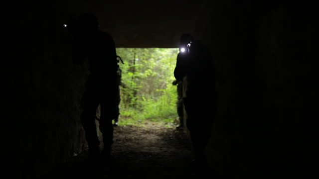 army men in abandoned tunnel - mercenary human role stock videos & royalty-free footage