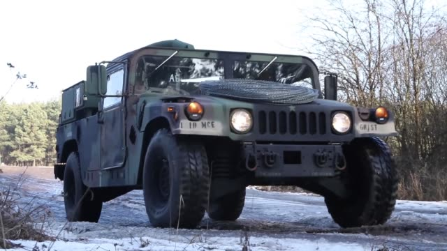 stockvideo's en b-roll-footage met us army mission command element 1st infantry division out of fort riley kansas conducts a command post exercise poznan poland on february 9 2019 - humvee