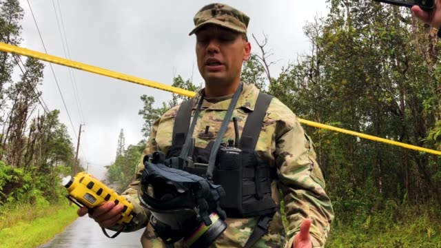 us army national guard first lt aaron hew len takes measurements for dangerous levels of sulfur dioxide gas on a residential street in the leilani... - evacuation stock videos & royalty-free footage