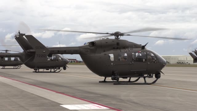 army national guard uh72 lakota helicopters take off for training and area familiarization flights during exercise patriot south 2019 at the air... - national guard stock videos and b-roll footage