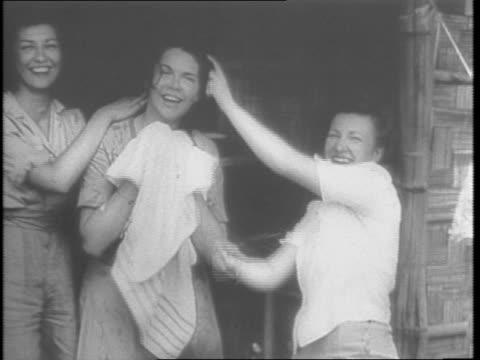 us army nurses healing american wounded on burma front take time off from duties to see sights of india / us flag on ship / soldiers down plank of... - anno 1943 video stock e b–roll