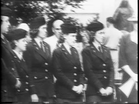 Army nurses walking in uniform / Nurses seated at ceremony / montage of Eleanor Roosevelt speaking to seated Army nurses / montage of nurses standing...