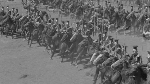 MS PAN Army of soldiers marching on horseback carrying flags / Unspecified