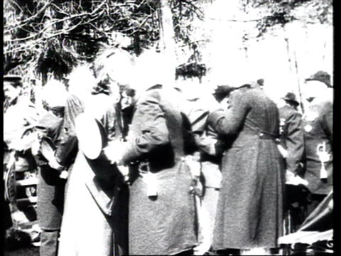 army officers clergymen and tsar nicholas ii meeting and kissing on cheeks during easter celebrations / russia - 1916 stock videos & royalty-free footage