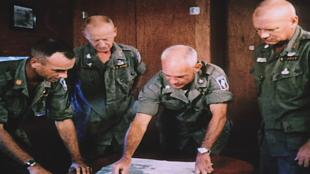 army officers, gathered around table and using easel, panning military strategy / vietnam - vietnam war stock videos & royalty-free footage