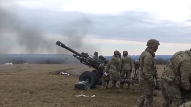 US Army Paratroopers assigned to Battery B 4th Battalion 319th Airborne Field Artillery Regiment 173rd Airborne Brigade conduct a fire mission with a...