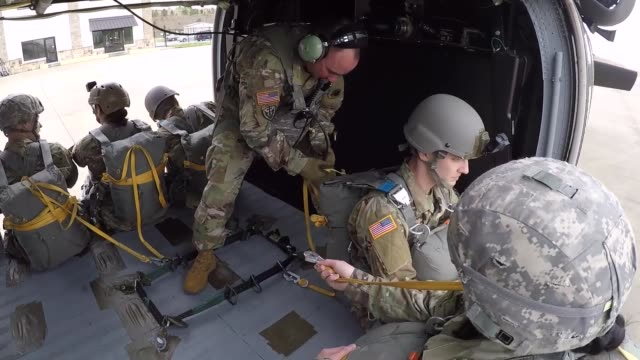 us army paratroopers conduct an airborne jump from an uh60 black hawk helicopter at spaulding county airport dallas georgia 13 april 2019 - black hawk helicopter stock videos and b-roll footage