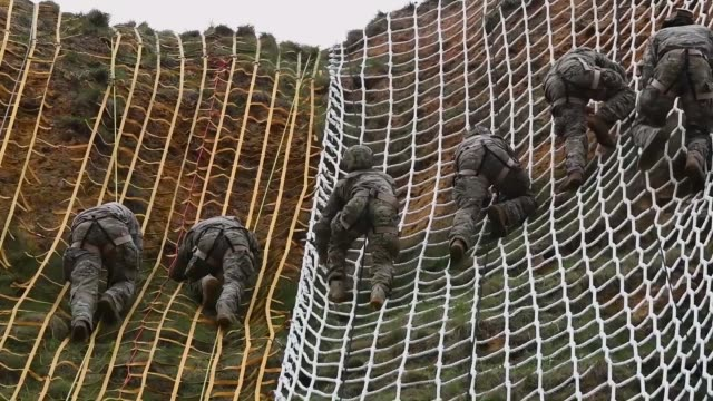 army rangers with the 75th ranger regiment climb pointe du hoc in normandy, france to commemorate the 75th anniversary of operation overlord, the... - 公園保安官点の映像素材/bロール