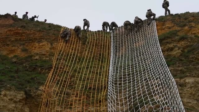 us army rangers with the 75th ranger regiment climb pointe du hoc in normandy france to commemorate the 75th anniversary of operation overlord the... - 75th anniversary stock videos & royalty-free footage