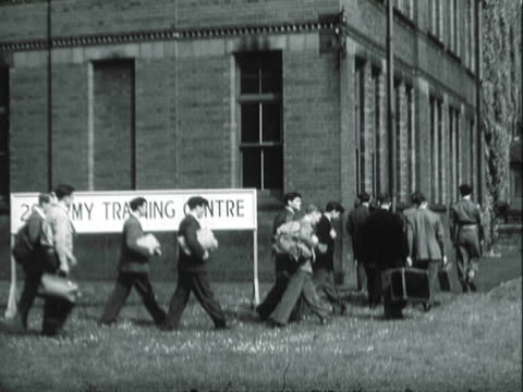 pan army recruits arriving at training center / united states - 1940 stock videos & royalty-free footage