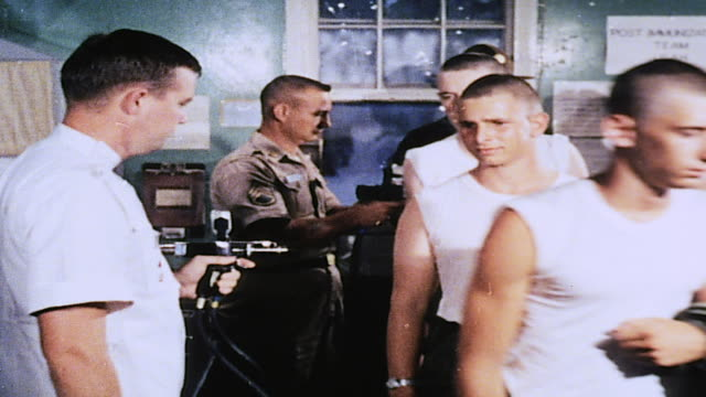 army recruits receiving inoculations, and doctor swabbing bare arm / fort leonard wood, missouri, united states - military recruit stock videos & royalty-free footage